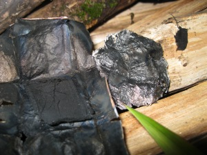 Even the thinnest foil can be folded around cotton cloth and cooked in the fire to produce charcloth, a tinder that lights with a spark and can be used to start fire.