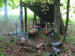 Brian Fries and Josh Stadler rest in our shelter, enjoying the Miracle Fire.