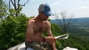 Checking the map at the vista on top of Knob Mountain. Photo/Josh Stadler