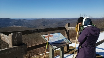 Josh and Gina check the marker while taking in the view at the top of High Knob.