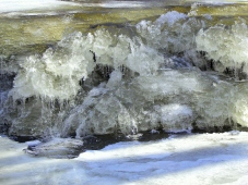 Creek water slaloms through the ice falls, around stilagtites, through frosty caves and ice bubbles, then shoots a luge into the slushy pool.